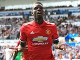 Paul Pogba celebrates getting the third during the Premier League game between Swansea City and Manchester United on August 19, 2017