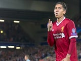 Roberto Firmino delivers an unorthodox celebration after scoring during the Champions League playoff between Liverpool and Hoffenheim on August 23, 2017