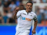 Roque Mesa in action during the Premier League game between Swansea City and Manchester United on August 19, 2017