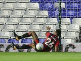 Tyrone Mings injures himself during the EFL Cup game between Birmingham City and Bournemouth on August 22, 2017