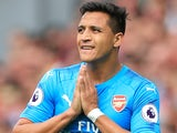 Alexis Sanchez prays during the Premier League game between Liverpool and Arsenal on August 27, 2017