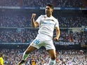 Real Madrid attacker Marco Asensio celebrates scoring against Barcelona in the Spanish Super Cup second leg on August 16, 2017