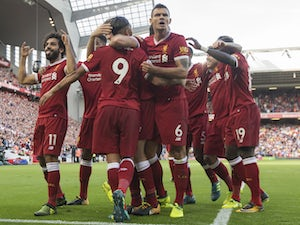 Mohamed Salah celebrates with teammates after scoring during the Premier League game between Liverpool and Arsenal on August 27, 2017