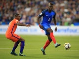 Paul Pogba is pursued by Georginio Wijnaldum during the World Cup qualifier between France and the Netherlands on August 31, 2017