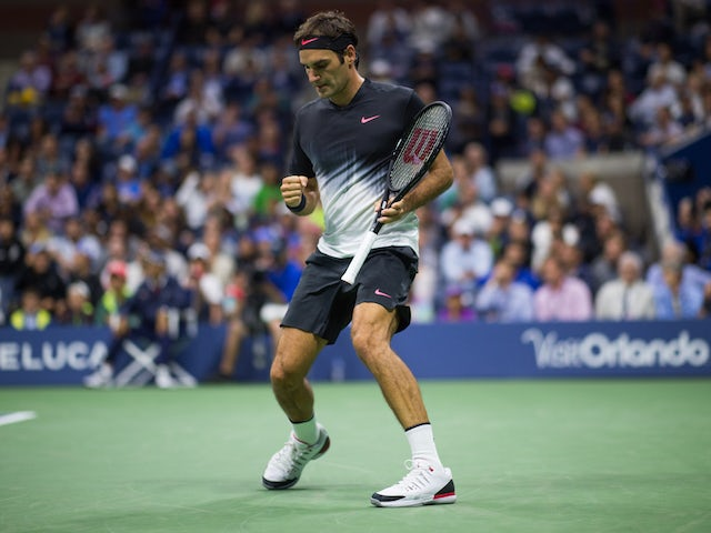 Roger Federer celebrates during the first round of the US Open on August 29, 2017