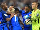 Thomas Lemar celebrates with teammates after scoring during the World Cup qualifier between France and the Netherlands on August 31, 2017