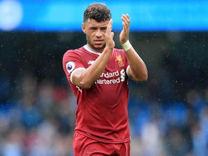 Alex Oxlade-Chamberlain celebrates during the Premier League game between Manchester City and Liverpool on September 9, 2017