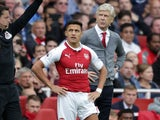 Arsene Wenger brings on Alexis Sanchez during the Premier League game between Arsenal and Bournemouth on September 9, 2017