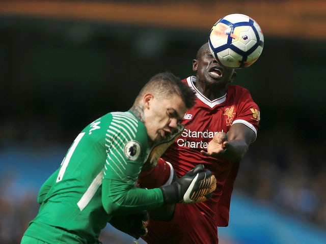 Ederson collides with Sadio Mane during the Premier League game between Manchester City and Liverpool on September 9, 2017