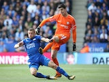 Jamie Vardy and Thibaut Courtois in action during the Premier League game between Leicester City and Chelsea on September 9, 2017