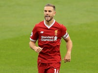 Liverpool captain Jordan Henderson barks orders during his side's Premier League clash with Watford at Vicarage Road on August 12, 2017