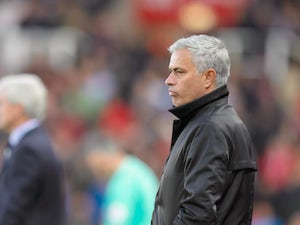 Jose Mourinho watches on during the Premier League game between Stoke City and Manchester United on September 9, 2017