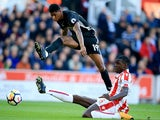 Marcus Rashford and Kurt Zouma in action during the Premier League game between Stoke City and Manchester United on September 9, 2017
