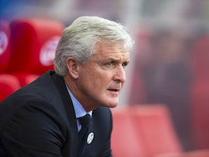 Mark Hughes watches on during the Premier League game between Stoke City and Manchester United on September 9, 2017