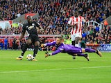 Romelu Lukaku scores his side's second during the Premier League game between Stoke City and Manchester United on September 9, 2017