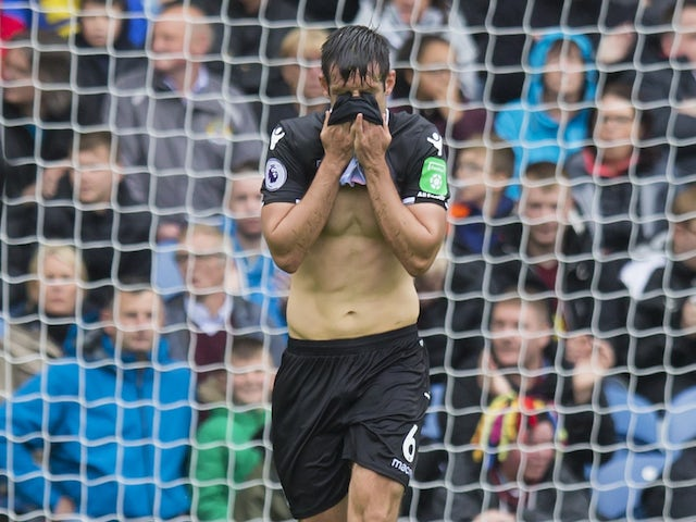 Scott Dann reacts to a missed opportunity during the Premier League game between Burnley and Crystal Palace on September 10, 2017