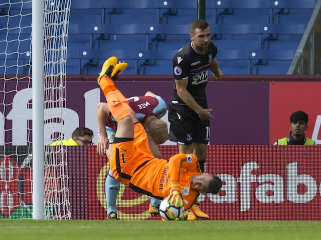 Tom Heaton is injured as he falls over Bee Mee during the Premier League game between Burnley and Crystal Palace on September 10, 2017