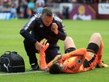 Tom Heaton receives treatment after going down injured during the Premier League game between Burnley and Crystal Palace on September 10, 2017
