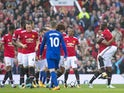 Antonio Valencia celebrates with teammates after opening the scoring during the Premier League game between Manchester United and Everton on September 17, 2017