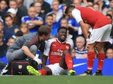 Danny Welbeck sits injured during the Premier League game between Chelsea and Arsenal on September 17, 2017