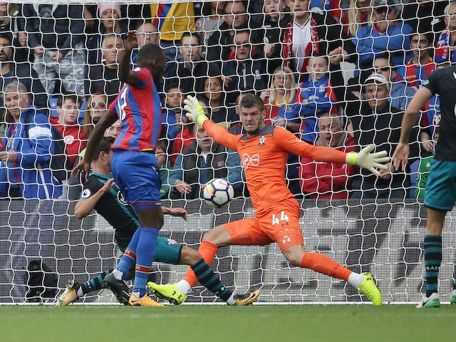 Fraser Forster saves a Christian Benteke shot during the Premier League game between Crystal Palace and Southampton on September 16, 2017
