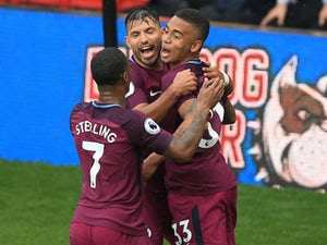 Man City thrash Watford to go top