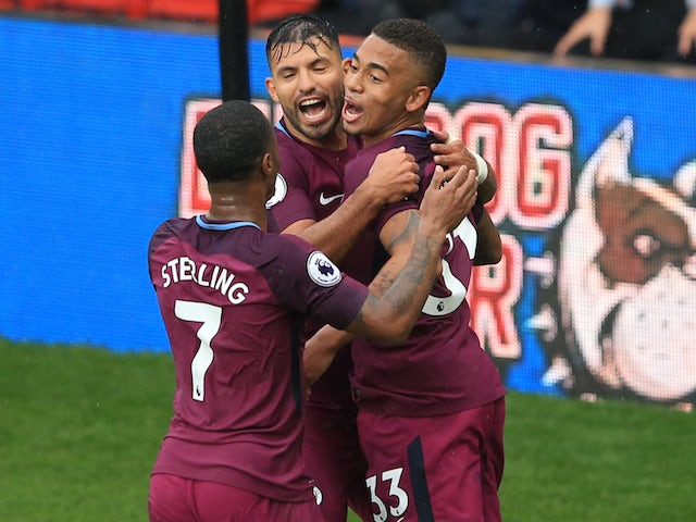 Gabriel Jesus celebrates the third with Sergio Aguero and Raheem Sterling during the Premier League game between Watford and Manchester City on September 16, 2017