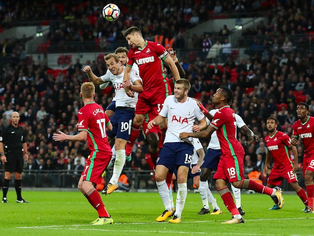 Harry Kane and Federico Fernandez battle for the ball during the Premier League game between Tottenham Hotspur and Swansea City on September 16, 2017