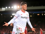 Sevilla forward Joaquin Correa clelebrates scoring for his side during their Champions League Group E clash with Liverpool at Anfield on September 13, 2017