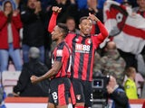 Jordon Ibe celebrates with Jermain Defoe during the Premier League game between Bournemouth and Brighton & Hove Albion on September 15, 2017