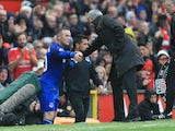 Jose Mourinho shakes Wayne Rooney's hand during the Premier League game between Manchester United and Everton on September 17, 2017