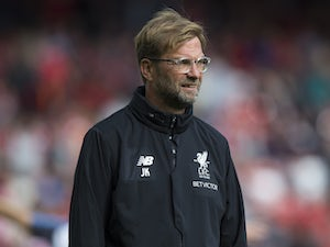 Jurgen Klopp watches the warm-up ahead of the Premier League game between Liverpool and Burnley on September 16, 2017