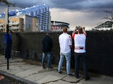 German fans urinate in a street near the Emirates ahead of the Europa League game between Arsenal and FC Koln on September 14, 2017