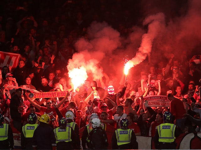 Flares are set off in the away end during the Europa League game between Arsenal and FC Koln on September 14, 2017