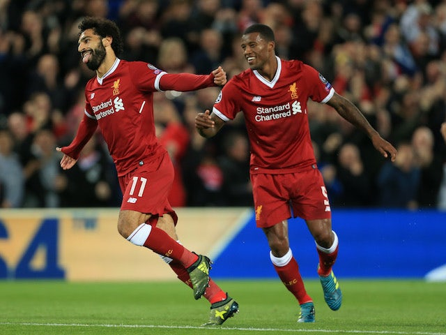 Liverpool winger Mohamed Salah celebrates after scoring during his side's Champions League clash with Sevilla on September 13, 2017