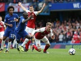 N'Golo Kante and Aaron Ramsey in action during the Premier League game between Chelsea and Arsenal on September 17, 2017