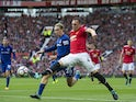 Phil Jones and young Tom Davies in action during the Premier League game between Manchester United and Everton on September 17, 2017