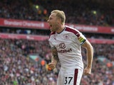 Scott Arfield celebrates opening the scoring during the Premier League game between Liverpool and Burnley on September 16, 2017
