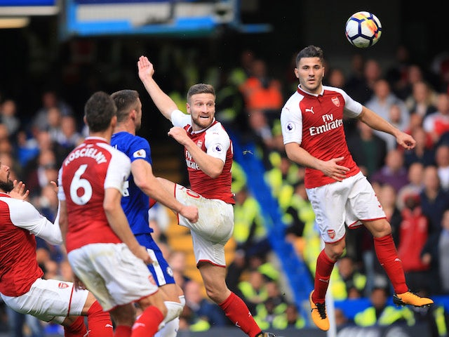 Shkodran Mustafi scores a disallowed goal during the Premier League game between Chelsea and Arsenal on September 17, 2017