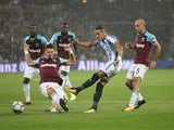 Tom Ince has a shot blocked during the Premier League game between West Ham United and Huddersfield Town on September 11, 2017