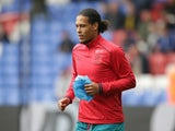Virgil van Dijk warms up prior to the Premier League game between Crystal Palace and Southampton on September 16, 2017