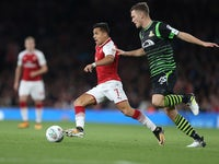 A terrified Alexis Sanchez is pursued by Joe Wright during the EFL Cup game between Arsenal and Doncaster Rovers on September 20, 2017