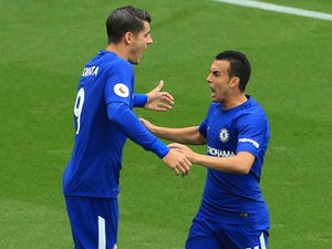 Alvaro Morata celebrates with Pedro after scoring during the Premier League game between Stoke City and Chelsea on September 23, 2017