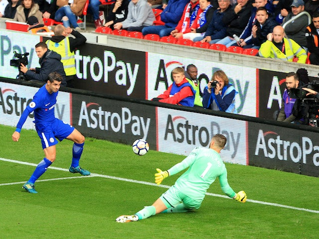 Alvaro Morata scores the Blues' third during the Premier League game between Stoke City and Chelsea on September 23, 2017