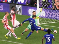 Alvaro Morata completes his hat-trick during the Premier League game between Stoke City and Chelsea on September 23, 2017