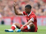 Liverpool striker Daniel Sturridge goes down injured during his side's Premier League clash with Middlesbrough on May 21, 2017