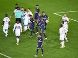 Paris Saint-Germain striker Edinson Cavani takes the ball off Neymar before missing his penalty during his side's 2-0 win over Lyon