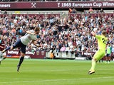 Harry Kane scores the first during the Premier League game between West Ham United and Tottenham Hotspur on September 23, 2017