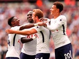 Harry Kane celebrates scoring the second with teammates during the Premier League game between West Ham United and Tottenham Hotspur on September 23, 2017