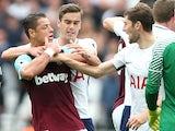 Harry Winks and Ben Davies restrain Javier Hernandez during the Premier League game between West Ham United and Tottenham Hotspur on September 23, 2017